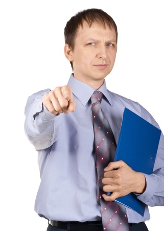 Portrait of confident businessman with blue folder pointing at camera, isolated on white photo