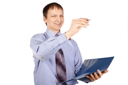 Happy young businessman holding blue folder and writing something with a pen, over white background Stock Photo - 10827334