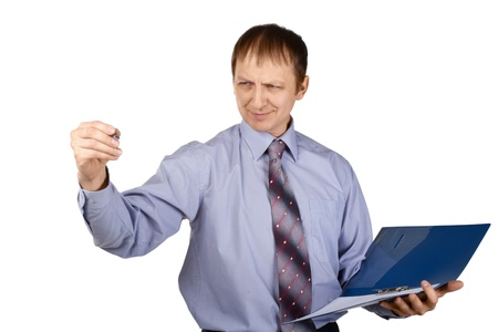 Portrait of  businessman holding blue folder and writing something with a pen, over white background Stock Photo - 10827373