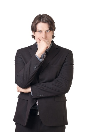 Portrait of thoughtful businessman covering his mouth by the hand, against white background