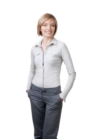 Smiling beautiful businesswoman with hands in pockets standing against isolated white background Stock Photo - 10827393