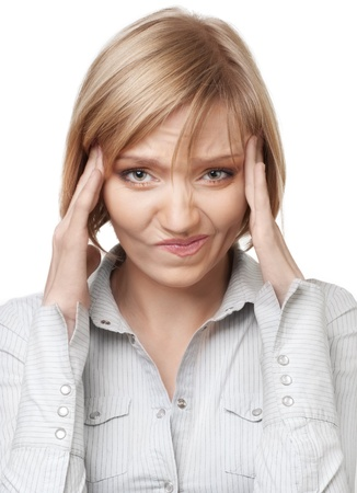 discontent: Attractive blond businesswoman having headache, isolated over white background Stock Photo