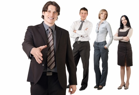 Smiling businessman  and his team ready to make a deal, against white background photo