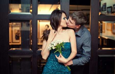 Beautiful young couple kissing  photo