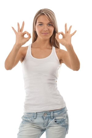 arm extended: Portrait of beautiful girl showing OK sign and smiling, over white background Stock Photo