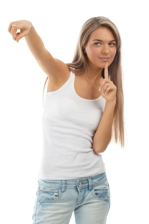 only teenagers: Portrait of beautiful casual girl pointing. Isolated on white background.
