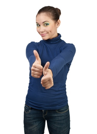 Smiling beautiful girl showing thumbs up, over white background photo