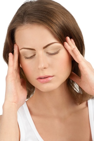 Close-up portrait of young beautiful woman having a headache against white background photo
