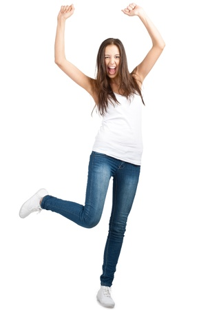 arm extended: Full length portrait of happy excited girl jumping with arms extended . Over white background Stock Photo