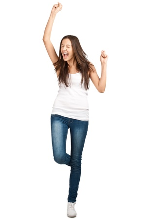 enthusiastic: Full length portrait of happy excited girl jumping with arms extended . Over white background Stock Photo