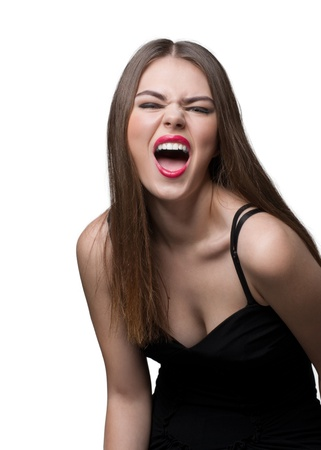 Portrait of screaming woman with make-up against white background photo