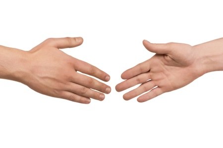 shake hand: Two male hands about to shake hands, over white background