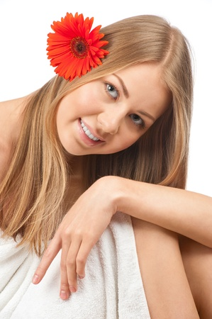 Portrait of young beautiful spa woman with flower in her hair. Isolated on white background Stock Photo - 10827676