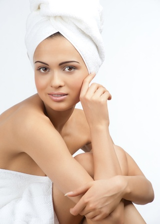 bare body women: Portrait of young beautiful spa woman wearing white towel. Isolated on white background.