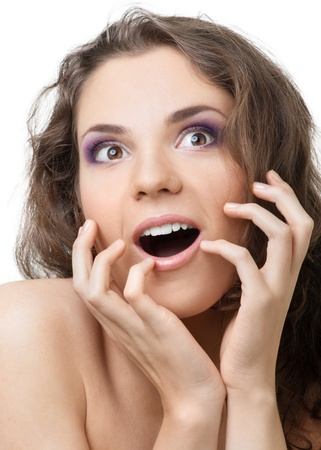 Close-up portrait of a surprised beautiful woman with open mouth over white background Stock Photo - 10841396