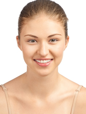 Close-up portrait of beautiful young woman with perfect healthy skin smiling, isolated on white background Stock Photo - 10841354