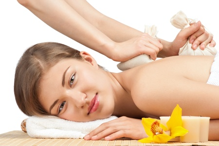 Beautiful young woman getting a massage lying on bamboo mat at spa salon Stock Photo - 10841364