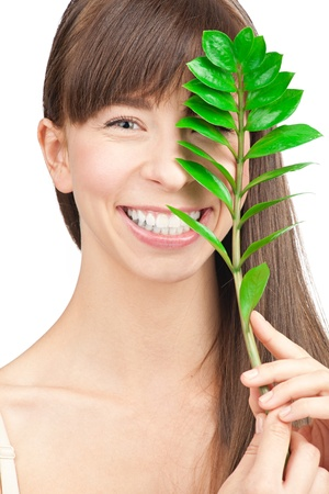 Closeup portrait of young beautiful woman with green leaf, over white background Stock Photo - 10841244
