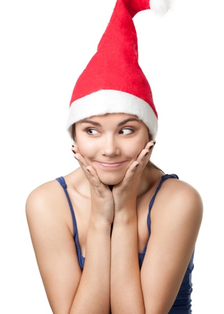 wearing santa hat: Portrait of pretty young woman wearing Santa hat against white background