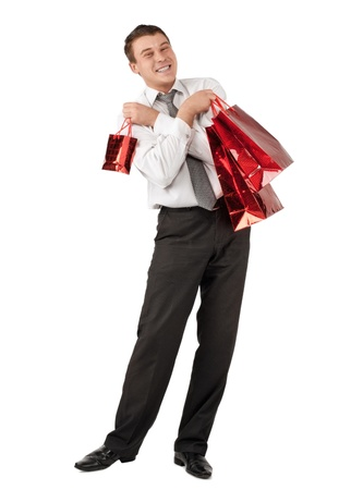 Happy young businessman holding a shopping bags with gifts for Valentine's Day Stock Photo - 10841690