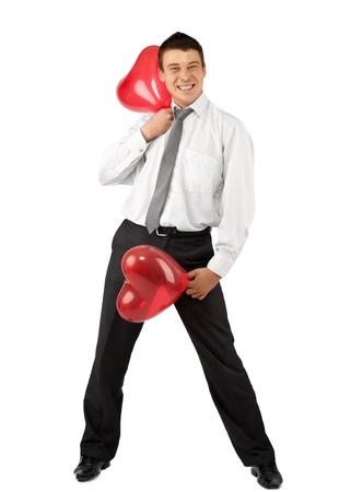 Smiling handsome man with two red heart-like balloons for Valentines Day, isolated on white photo