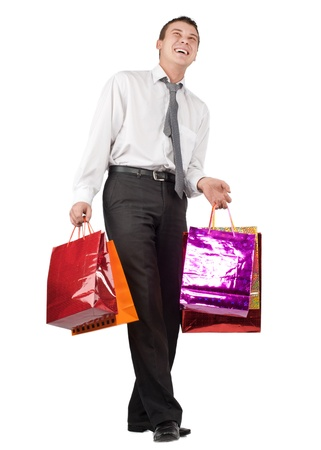Happy businessman with many shopping bags against white background photo
