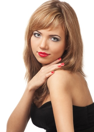Portrait of beautiful blond woman with red manicure and red lips against white background photo