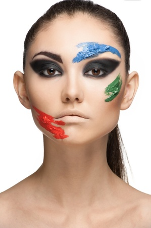 Fashion make-up with face art. Close-up portrait of beautiful young woman isolated on white background. Stock Photo - 10841323