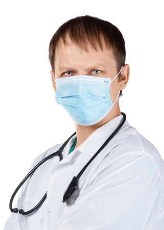 Portrait of a doctor wearing blue surgical mask against white background photo
