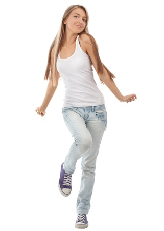 woman dancing: Happy beautiful girl dancing and celebrating standing in full length, isolated on white background