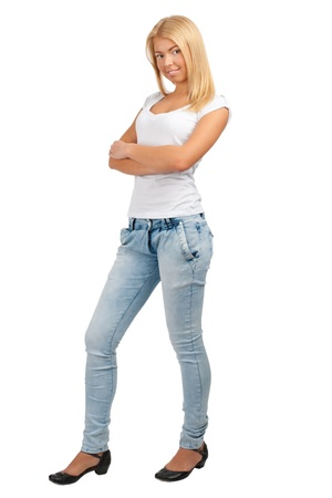 Full length portrait of a happy young female standing with folded hands against white background photo