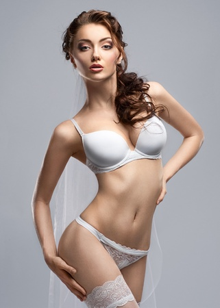 nude bride: Portrait of a sexy bride wearing white lingerie