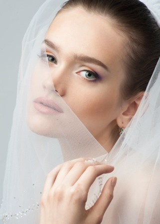 Portrait of a beautiful bride with bright makeup photo