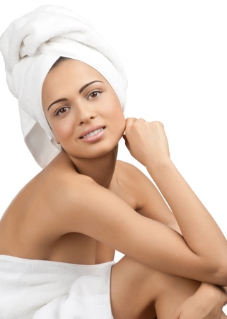 bare women: Portrait of young beautiful spa woman wearing white towel. Isolated on white background.