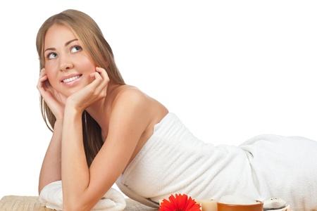 Portrait of young beautiful spa woman lying on bamboo mat at spa salon Stock Photo - 10844646