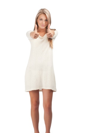 Full length portrait of a pretty young woman smiling and showing thumbs up, against white background Stock Photo - 10844440