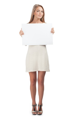 Portrait of a young beautiful woman holding a blank signboard, isolated on white background photo