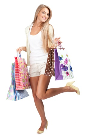 woman shopping: Happy beautiful  woman with colorful shopping bags in her hands Stock Photo