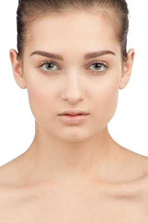 Close-up portrait of beautiful young woman with perfect healthy skin. Isolated on white background Stock Photo - 10844674