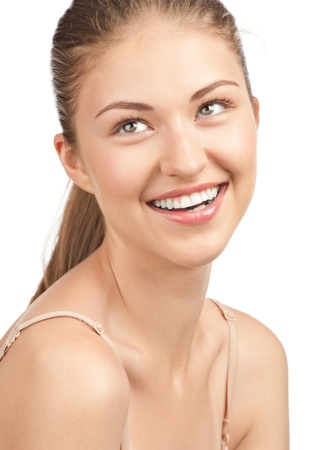 Close-up portrait of beautiful young woman with perfect healthy skin and natural makeup, isolated on white background Stock Photo - 10844793