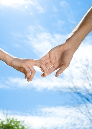 Closeup of a hands of a couple outdoors photo