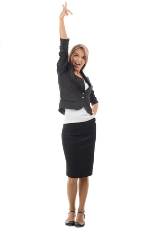 woman pointing up: Full length portrait of successful young businesswoman celebrating her victory. Isolated on white background