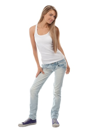 only teenagers: Full length portrait of beautiful casual girl posing and smiling. Isolated on white background. Stock Photo