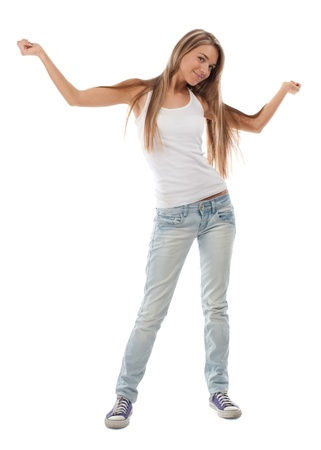 arm extended: Full length portrait of happy dancing girl with arms extended . Over white background Stock Photo