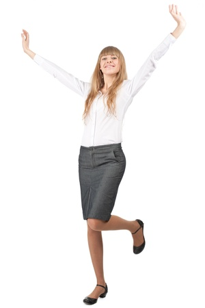 Full length portrait of successful young businesswoman raising her arms in joy. Isolated on white background photo