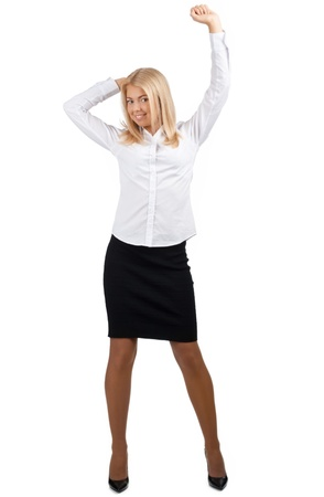 raised arms: Full length portrait of successful young businesswoman raising her arms in joy. Isolated on white background Stock Photo