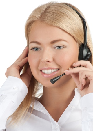 Close-up portrait of a pretty young female call center employee wearing a headset, against white background photo