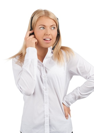telephonist: Portrait of a surprised female call center employee wearing a headset, against white background