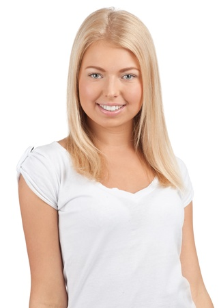 Portrait of a happy young woman smiling and looking at camera, against white background