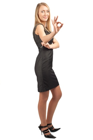 all right: Full length portrait of confident young businesswoman showing OK sign and smiling, over white background
